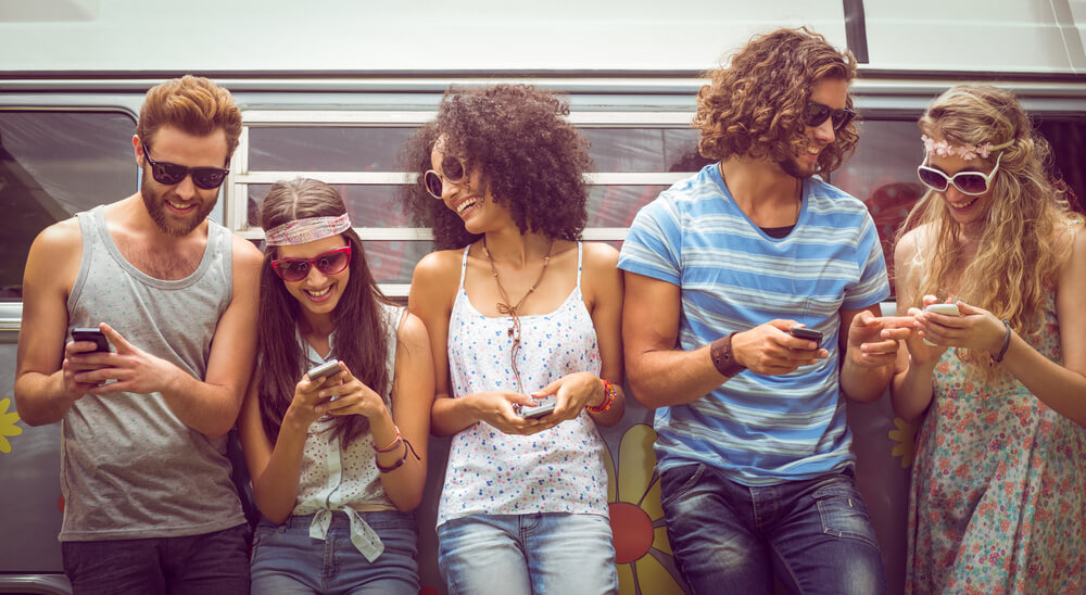 5 friends having fun over mobile